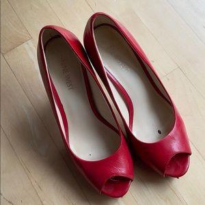 Red platform pumps with peep toe